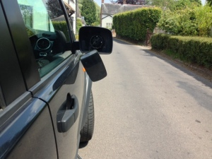 Damage to a Land Rover discovery wing mirror - discovered on Saturday 6 July 2013.  At this height it suggests the car was hit either by another 4x4 or a lorry. Sadly, no note was left admitting responsibility.